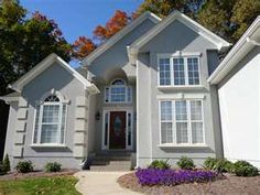 Picture of A nice grey stucco house with a nice flower garden in ...