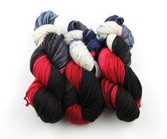 """Gothic Sorceress is my submission to the October 2016 Phat Fiber """"Good Goth"""" box. Dyed in bold shades of crimson red, black and blue/purple with shades in between, this colorway conveys the power and majesty of the mystics. The yarn is a soft and warm merino wool, a good staple that you can really make anything with.  #yarn #knitting #crochet"""