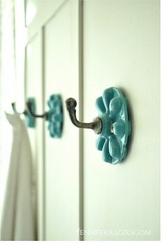 aqua hooks, love wood idea behind them so wet towels won't mess up wall.