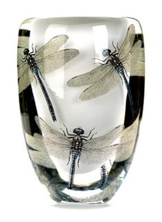 Slender dragonfly forms embedded in the glass mass is one of the hall marks of the mask glassworks.