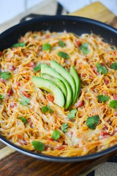 Sopa Seca de Fideo: Vermicelli is toasted in a skillet and cooked in a flavorful mix of broth and tomatoes, then topped with Monterey Jack cheese.