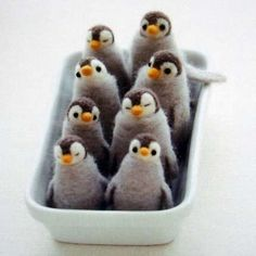 felt crafts penguins. Not sure what I would do with these except look at them and admire how cute they are...but that's a good enough reason to make them right??