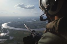 An American machine gunner on patrol by helicopter over Vietnam's Mekong Delta in 1967    Read more: http://life.time.com/culture/1967-pictures-from-a-pivotal-year/#ixzz1qWwxAYHd