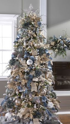 Winter Christmas tree decoration with blue, gold and silver along with burlap ornaments. decor blue gold 20 Most Adorable Collection Of Rustic Christmas Tree Decor Ideas - Blurmark Silver Christmas Tree, Beautiful Christmas Trees, Noel Christmas, Rustic Christmas, Christmas Tree Ribbon, Champagne Christmas Tree, Magical Christmas, Christmas Trees With Burlap, Christmas Lights