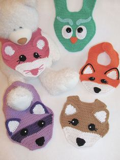 "Stitch an adorable bib for your baby!   These darling bibs feature an owl, fox, deer, raccoon and a mouse. Designs are crocheted with cotton worsted-weight yarn. Size: 8""W x 7""H, not including straps."
