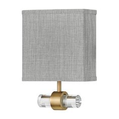 Inspired by its lustrous appeal, Luster is a supremely suitable wall sconce for a variety of hospitality or residential settings. Luster features a clear glass rod with chic beveled ends, and comes in either a Brushed Nickel or Heritage Brass finish met w Brass Sconce, Led Wall Sconce, Sconce Lighting, Wall Sconces, One Light, Light Led, Hinkley Lighting, Fabric Shades, Grey Fabric