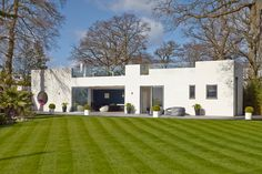 House in Hamble-le-Rice consisted of a complete renovation, extension, and a roof terrace addition to a 1930s Bauhaus style home overlooking a marina.