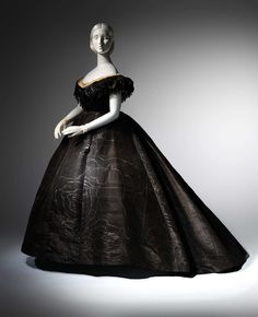 """Evening Dress, 1861 -- """"Death Becomes Her"""" mourning fashion from 1815 to 1915 exhibit at the Met."""