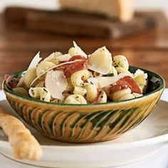 Cavatappi Pasta with Prosciutto and Parmesan  http://www.myrecipes.com/recipe/cavatappi-with-prosciutto-parmesan-10000001654682/