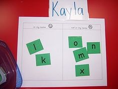 The kids take a little box of letter tiles and sort letters that are in their name and not in their name.