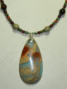 African Opal Aqua Terra Impression Jasper Wire Wrapped Necklace with Garnet Agate and Gold Stone by AngelStarJewelry on Etsy