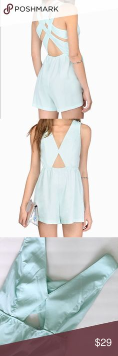 Tobi Mint Romper Tobi Sweet Symmetry Mint Romper. New with tags. There is a cut out in the front and the straps cross in the back. In very good condition.   ⭐️10% off 2+ bundle  ⭐️Size Large  ⭐️Smoke free home  ⭐️No stains or flaws Tobi Dresses Midi