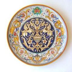 """DECORATIVE DISK: GOLD RAFFAELLESCO SURROUND/BLU GROTTESQUE-1 CENTER: 18"""" (46cm) Diameter.    This Disk is Drilled for Hanging.    This Piece is hand painted in Deruta."""
