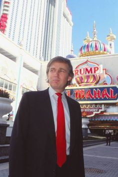 Businessman Donald Trump stands in front of Taj Mahal Casino Hotel in April 1990 in Atlantic City New Jersey