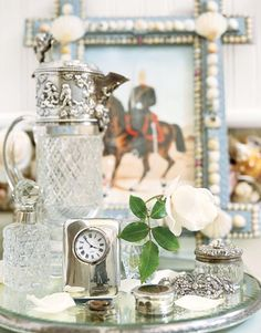 Silver pieces on a lovely vanity tray, from Confetti Style