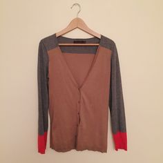 Ann Taylor color block cardigan 100% cotton, like new (only worn less than four times), hits past the hip. There's a tiny little paint mark on the back that can easily be washed out. Ann Taylor Sweaters Cardigans