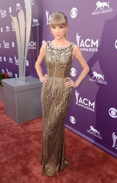 Taylor Swift in a gold #DolceGabbana gown at the 2013 #ACM Awards. See more celebs on Wonderwall: http://on-msn.com/16IvjA1