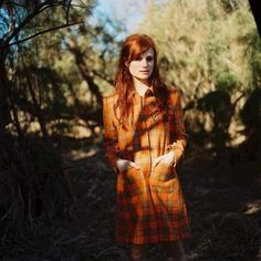 {Open} The Ginger girl walked down a path not too far from their shelter to look for firewood. She heard a branch snap behind her, making her spin around, holding her knife up. When Mal sees it's just (Y/C) she let's out a breath of relief.