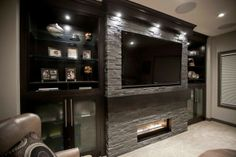 Man cave. Maybe just partial stone wall instead of the whole wall