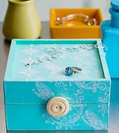 Bedside Treasure Chest        Store the items that accumulate on your nightstand in their very own treasure chest. Purchase an inexpensive unfinished wooden storage box from a crafts store. Paint it a bright color. Freehand-paint a design on the base and lid, or use a stencil or stamp instead. Finally, glue a medallion, button, or large bead to the front of the lid to serve as a handle.