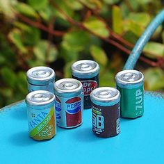 Soda Cans www.teeliesfairygarden.com . . . A great way to cool down from blazing sun while hanging out at the beach. These soda cans will make the fairies sigh with relief as they want to cool off by the beach. #fairysoda