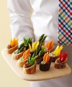 Individual Crudité - hollowed-out slices of baguettes, dips and some chopped veggies.