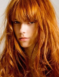 Redhead? Check. Full bangs? Check. Style? You bet.