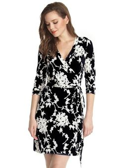 You'll never look boring in this stunning black floral plunge wrap dress, whether for a social gathering or for the office.