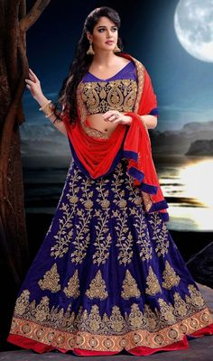 Look sensationally awesome in this bluish purple color embroidered velvet lahenga choli. Look ravishing clad in this attire which is enhanced lace, resham and stones work. #gorgeousloolehengas #floralworkcholis #floraldesigncholie