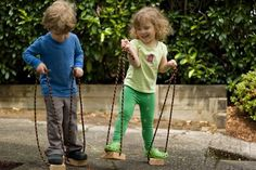 Made by Joel, 'Toddler Stilts,' which he whipped up with wood and rope. They are a throwback to the old coffee can stilts of yesteryear, but they keep young kids safer and closer to the ground!  I love the thought of using these stilts to help kids hone their coordination and concentration skills.