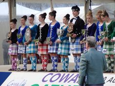 Close up on the line up of 2014 Juvenile: Erin Blair (USA) Highland Dancing World Champion and runners up. Scottish Highland Dance, Scottish Highlands, Tartan Kilt, How To Make Handbags, Lineup, Dance Wear, Scotland, Dancing, Champion
