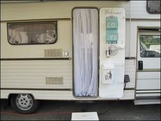 "similar to one of ""our"" motorhomes in Europe. Love what they've done to this one, BUT all that white willl be very impractical for actually LIVING!!! Great use of the door though."