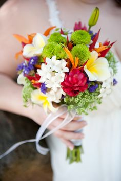 The stephanotis and plumerias made this bouquet smell amazing! Tropical bridal bouquet by Stacy