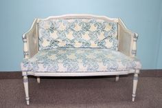 blue and white floral loveseat
