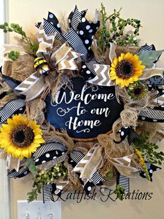 "Custom Order -- Faux burlap deco mesh wreath with rustic ""welcome to our home"" chalk sign, sunflowers, wired ribbon and greenery.  This wreath has SOLD, but I do have more signs and can make another one very similar.  Contact me at:  https://www.facebook.com/Kattfish-Kreations-659509324079375/"