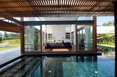 Living room surrounded by pool