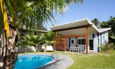 The homes blend modern architecture with Hawaiian vernacular.
