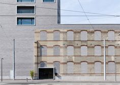 Zurich building by E2A incorporates the facade of a century-old warehouse.