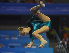 Russia's Alla Sosnitskaya performs on the beam during the women's qualification at the Gymnastics World Championships in Nanning, in China's southern Guangxi province on October 5, 2014. (c)AFP/Greg BAKER ▼13Oct2014AFP|【写真特集】カメラがとらえた世界体操のワンシーン http://www.afpbb.com/articles/-/3028472