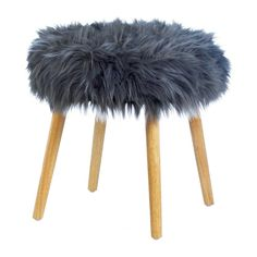 Texture, comfort, and style is what this charming stool delivers to your living space every day! Rest your feet on the exceptionally soft gray faux fur pad and relax in style.
