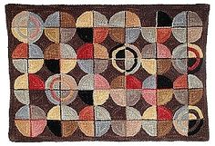 """Fandango (H630) is a super interesting wool tufted rug. Its chocolate field sets up the colorful whimsical circles. The design is the same as HC708 Camp Tekoa, but that rug is hooked with cotton strips and this rug is tufted with wool yarn. The yarn is hand dyed, thus creating a nice hand made look with the variegated colors. And what is Fandango other than a word that means something like a """"confused mess of stuff"""" Fandango is a lively folk and Andalusian (flamenco)"""