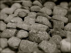 PRAYER STONES IN TIBET  In Tibet, the Buddhist tradition of carving religious verses in stone became a popular folk art with many different forms. Usually, single stones are inscribed or commissioned by individuals and brought to a blessed site, where over time, they accumulate into great piles or even into mile-long walls of stones which become a focus of devotion and prayer. la_gronchi