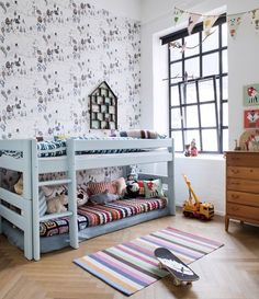 low bunk beds and wallpaper focal wall, kids room