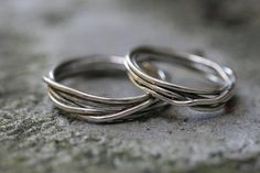 "nice wedding band shape if it was made of three ""strands"""
