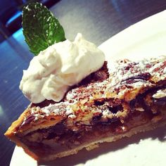 Pecan chocolate tart served w/ a Bulleit bourbon whipped crème ...