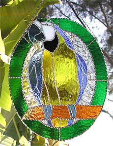 """Stained Glass Tropical Blue & Gold Macaw Parrot Suncatcher Design - 10"""" x 12"""" - $54.95  - Stained Glass Tropical Designs   - Glass Suncatchers, Stained Glass Décor, Stained Glass Sun Catchers -  Stained Glass Design  * * More at www.AccentOnGlass.com"""