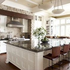 White kitchen cabinets and walls with dark countertops and flooring