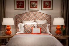 Quick color hits work well in the showroom the same way they do in someones home!  Here I used the great headboard fabric with the great orange tone and then supported the color balance with the bright orange ceramic lamps!  Accessories are a great way to back up your color punch!