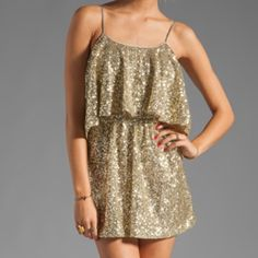 FREE PEOPLE Dress Sequin Mini Cutout Back Shift Size Small. New With Tags. $220 Retail + Tax.    Sequin mini dress with open back and ruffle overlay.  Satin lining,elastic waistband and adjustable straps.  By Lovers + Friends for Free People.   Polyester.  Imported.      ❗️ Please - no trades, PP, holds, or Modeling.    Bundle 2+ items for a 20% discount!    Stop by my closet for even more items from this brand!  ✔️ Items are priced to sell, however reasonable offers will be considered when…
