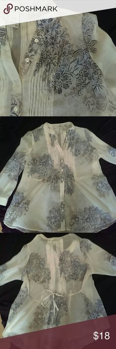 American Tag Sheer Blouse Beautiful blouse with antique rose print.  Pleated front and back with 3/4 length sleeves.  Excellent condition!  Worn twice.  Too big for me now. American Rag Tops Button Down Shirts